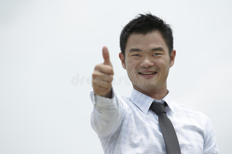 Download Asian Man With His Thumb Up In Agreement Stock Image - Image: 21662123