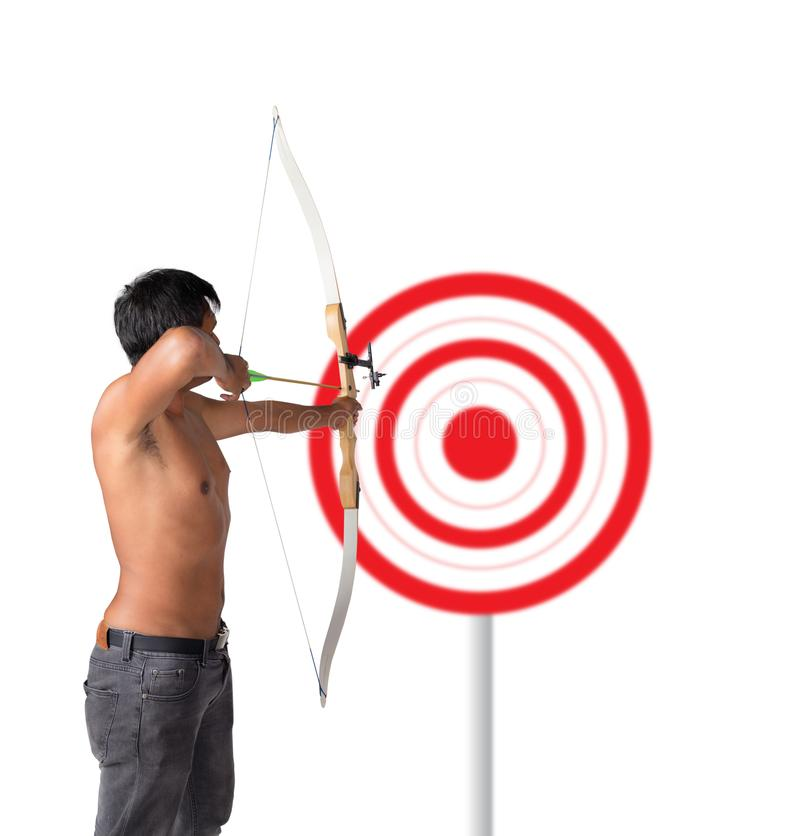 Asian man holding bow and shooting to archery target. Rear view, businessman aiming at target stock image
