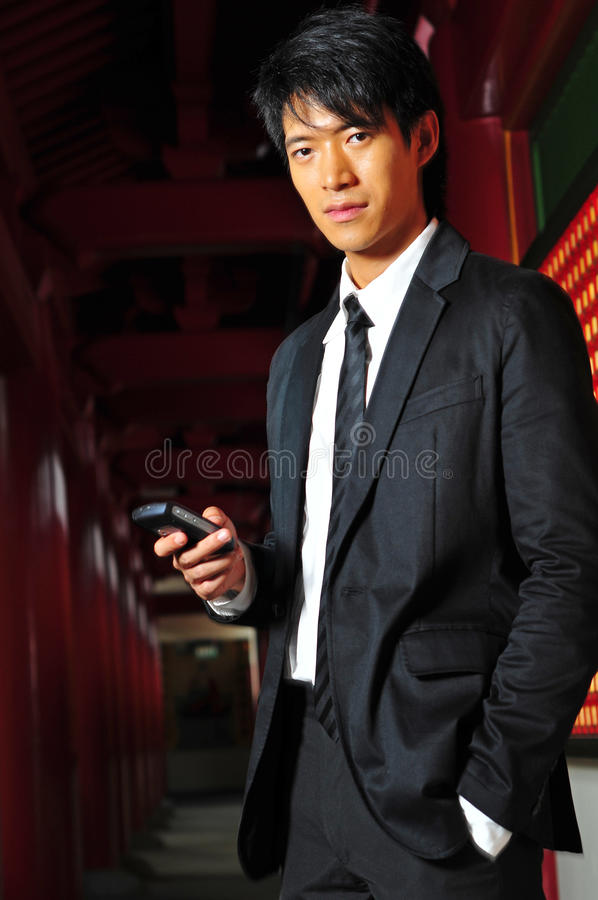 Free Asian Man In Suit With Phone Stock Photos - 9409243
