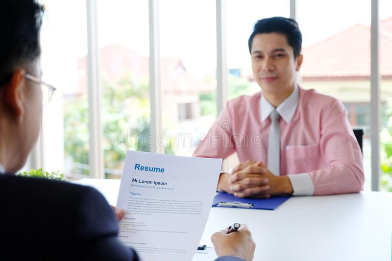 Asian man in job interview at office background, job search, business concept royalty free stock photography