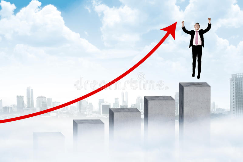 Asian man jumping on the chart stock image