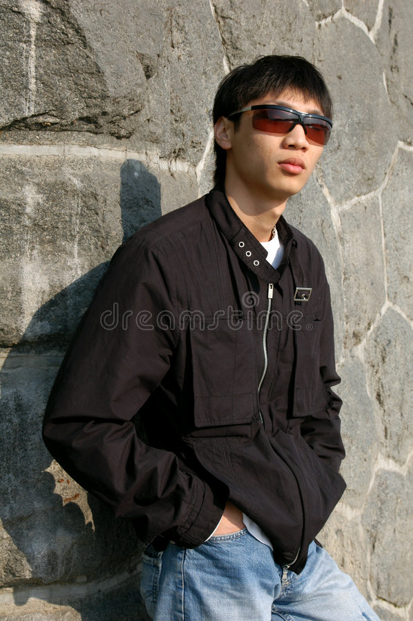 Asian Man Leaning against a Wall stock photos