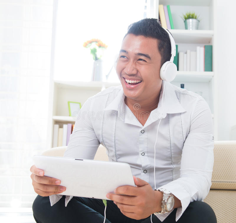 Download Asian Man Listen Music With Headphone Stock Photos - Image: 28185503