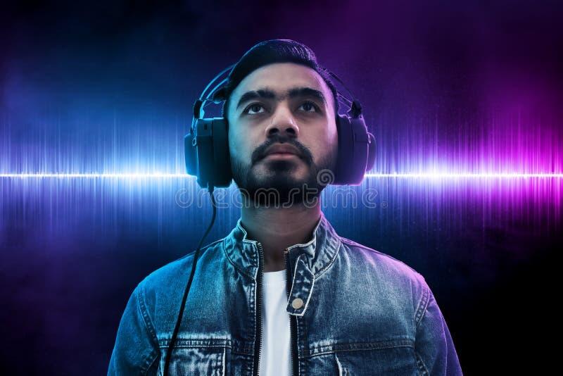 Asian man listening music wearing headphone stock photo