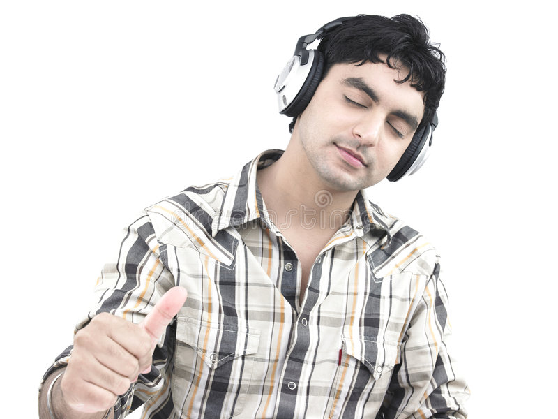 Asian man listening to music stock images