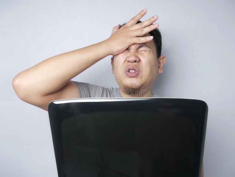 Asian Man Looked Regret and  Disappointed Expression Looking at Laptop royalty free stock photo