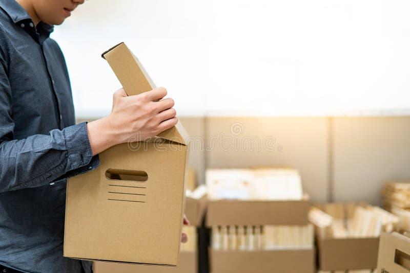 Asian man opening cardboard box lid stock photos