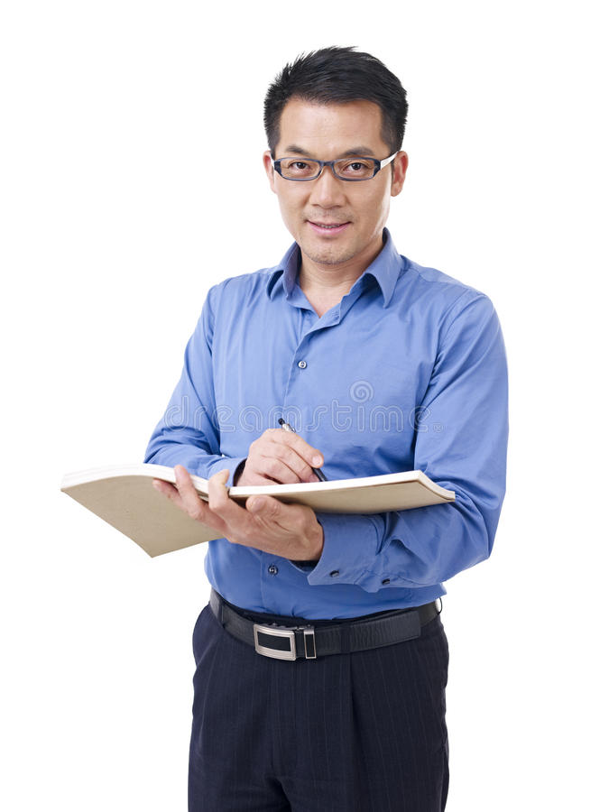 Asian man with pen and notebook stock images