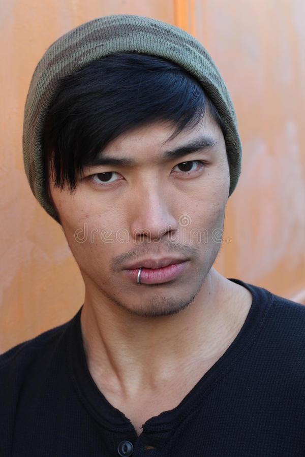 Asian man with piercing and beanie.  royalty free stock photos