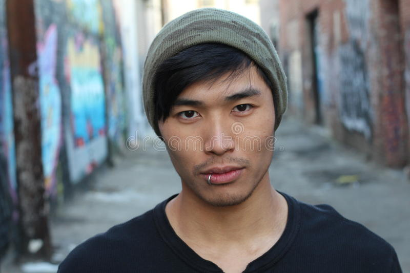 Asian man with piercing and beanie royalty free stock images