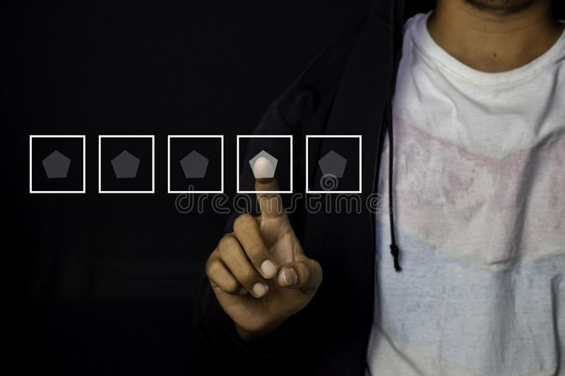 Asian Man pointed and give rating for 4 star icon for customer isolated on black background royalty free stock image