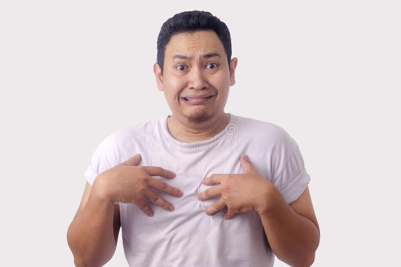 Asian Man Pointing Himself with Unhappy Expression as if he confused to be accused royalty free stock photography