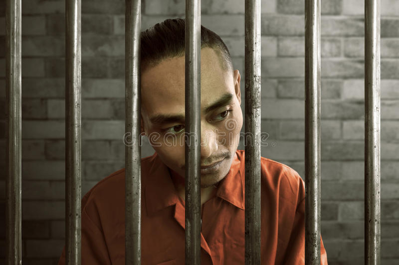 Asian man in prison royalty free stock photo