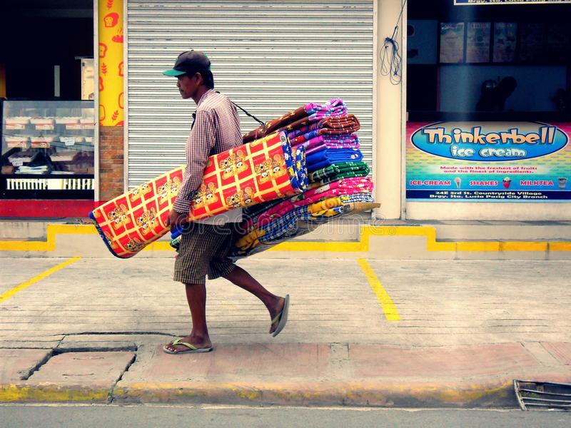 Asian man selling or peddling bed cushion stock images