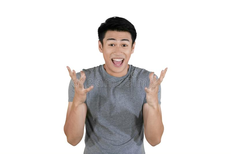 Asian man showing surprised expression on studio royalty free stock photography