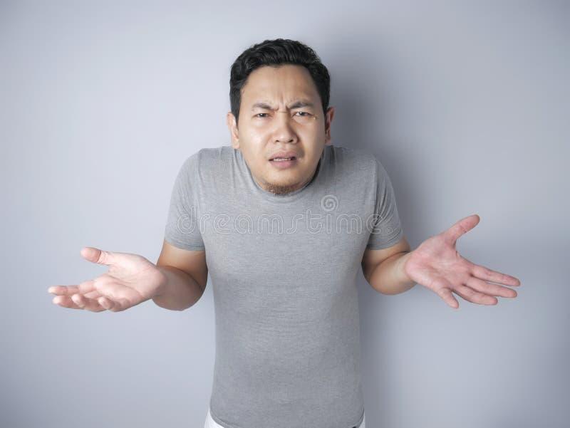 Asian Man Shrug Shoulder I don& x27;t Know Gesture stock image