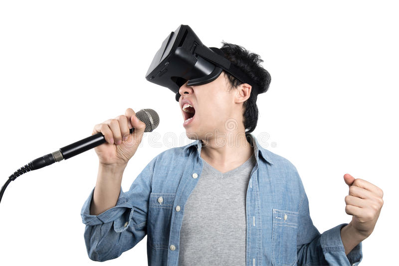 Asian man singing with VR stock image