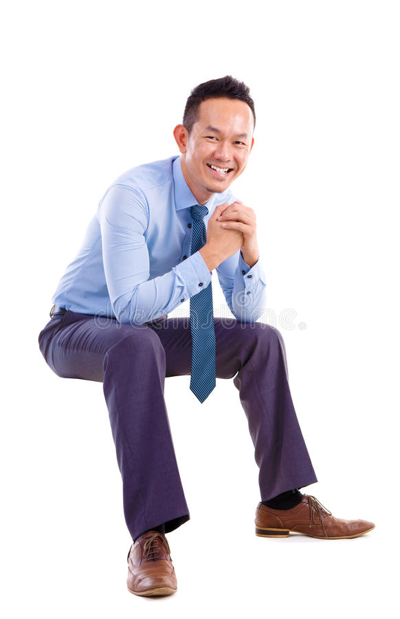 Asian man sitting on transparent chair