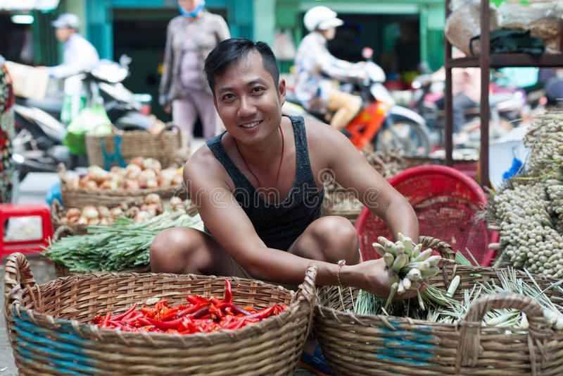 Asian man street market seller bunch green onion. Asian man on street market seller hold bunch of green onion stock photo