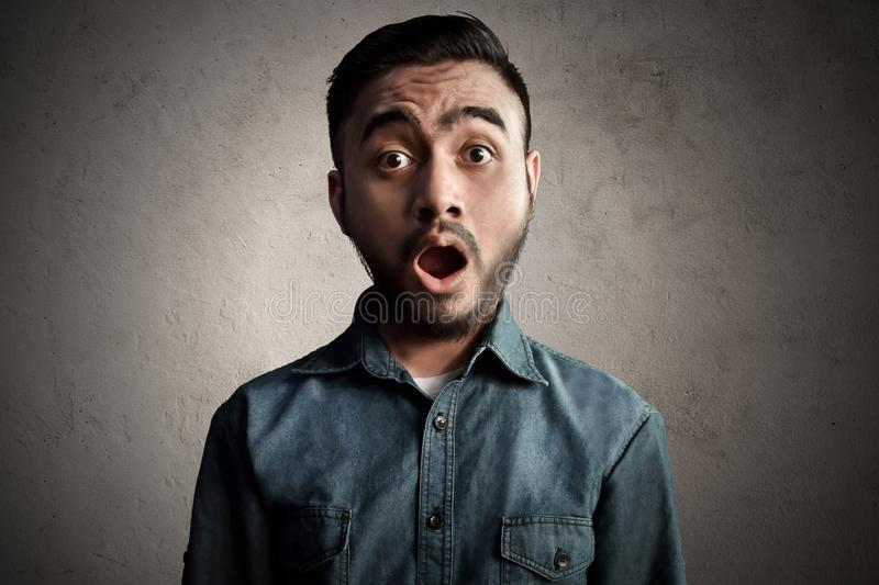 Asian man surprised and shock royalty free stock photo
