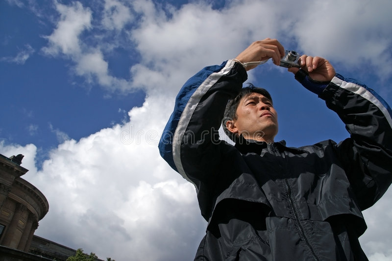 Download Asian Man Taking Photograph Stock Image - Image of background, young: 1405773