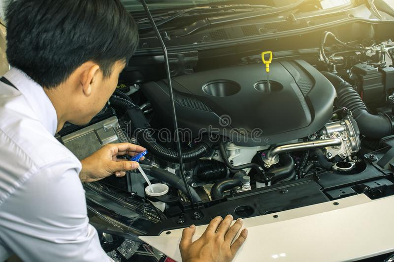 Asian man with technology engine royalty free stock photography