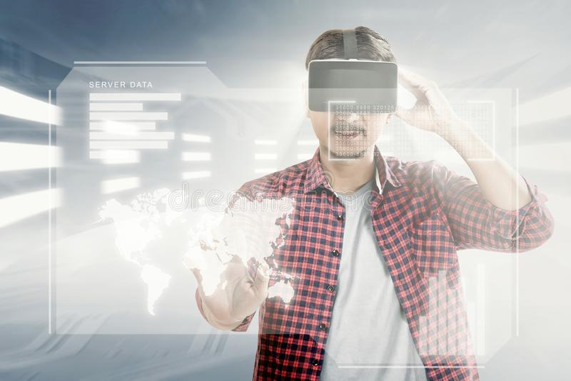 Augmented reality technology. Asian man touching world map on digital interface with virtual reality device display the world map, graphic bar and binary code royalty free illustration