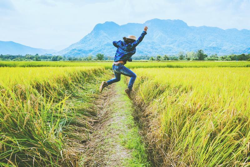 Asian man travel relax in the holiday. Jump natural touch mountain field. Jump stand glad middle field rice. Thailand. Asian man travel relax in the holiday stock images