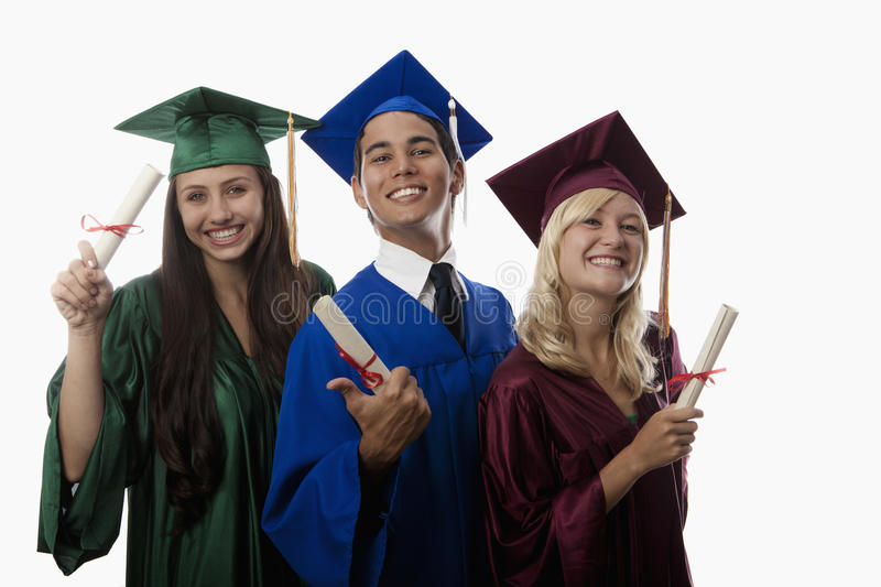 Asian man and two women graduates royalty free stock image