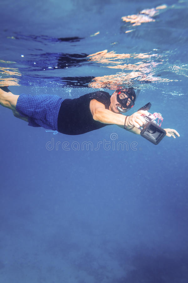 Asian Man with Underwater Boxed Camera royalty free stock photo
