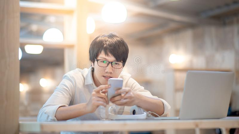 Asian man using smartphone on social media royalty free stock photos
