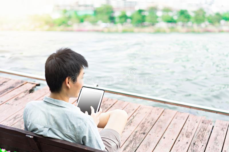 Asian man using tablet in everyday life royalty free stock photo