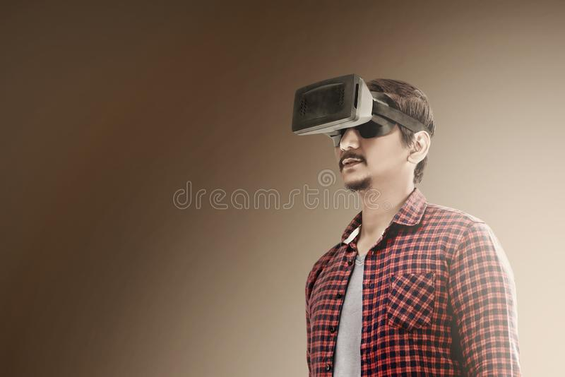 Augmented reality technology. Asian man using virtual reality device. Augmented reality technology royalty free stock photography