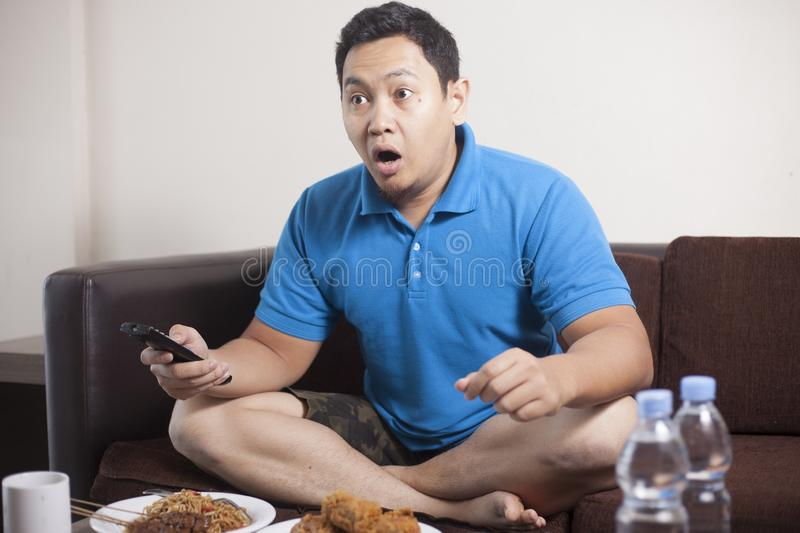 Asian Man Watching Soccer on TV royalty free stock photo
