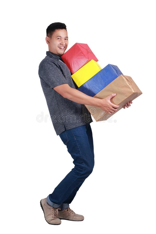 Young Man Carying Boxes of Gift royalty free stock photo