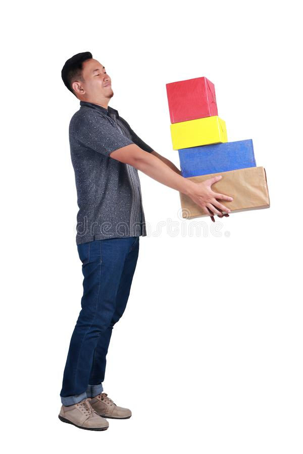 Young Man Carying Boxes of Gift royalty free stock image