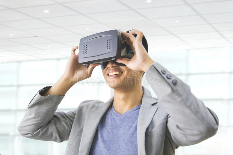 asian man wearing virtual reality goggle stock image