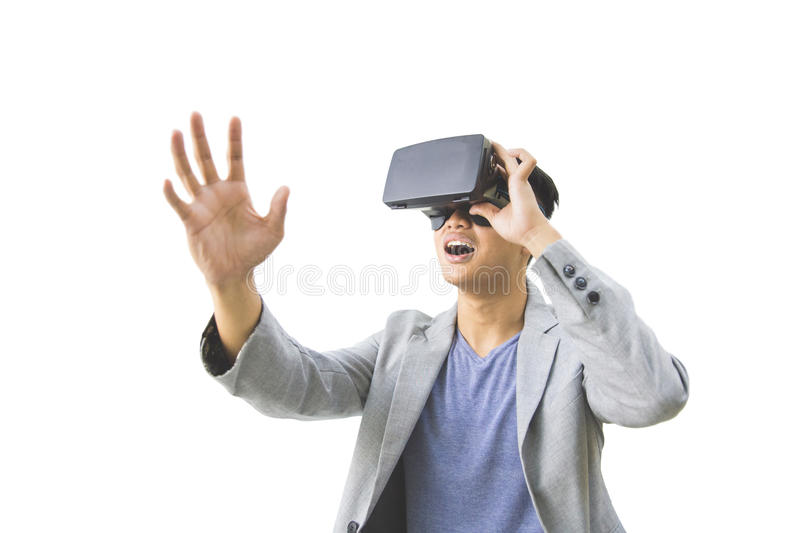 Asian man wearing virtual reality goggle. Portrait of asian man wearing virtual reality goggle isolated over white background royalty free stock images