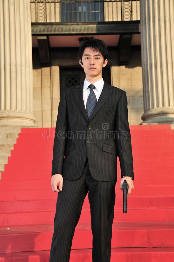 Free Asian Man With A Gun Looking Into The Camera 3 Royalty Free Stock Photos - 17571308