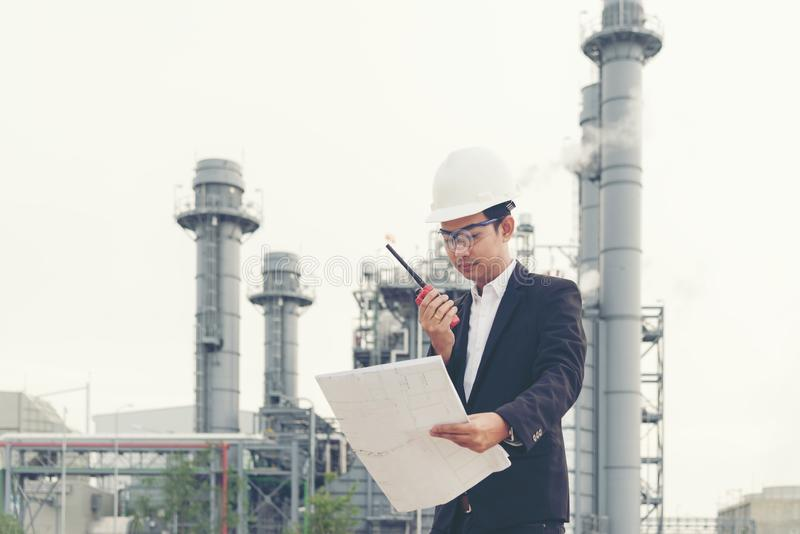 Asian man work experience and professional occupational engineer electrician with safety control at power plant energy industry an stock photo