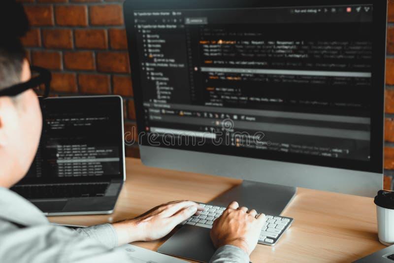 Asian man working code program developer computer web development working design software on desk in office.  stock photos