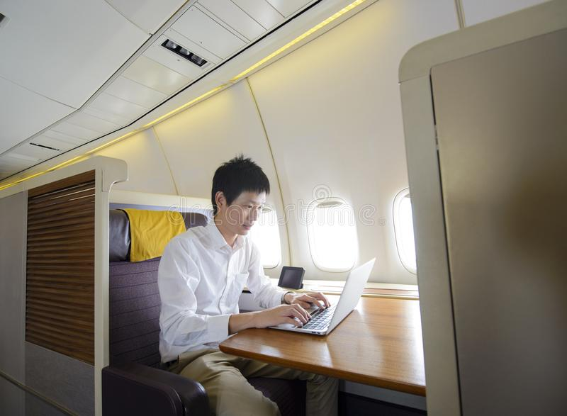 Asian man working on first class airplane.  stock images