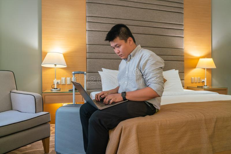 Asian man working on laptop in business trip royalty free stock photos