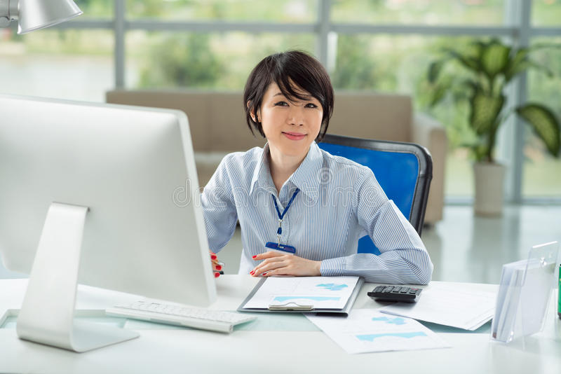 Asian manager. Young Asian manager working on computer royalty free stock photos