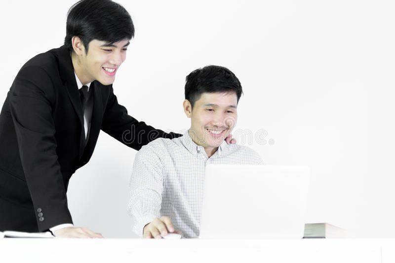 Asian manger businessman and employee salary man has working tog. Asian manger businessman and employee salary men has working together with feeling happy and stock images