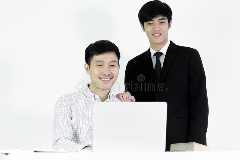 Asian manger businessman and employee salary man has working tog. Asian manger businessman and employee salary men has working together with feeling happy and royalty free stock photo