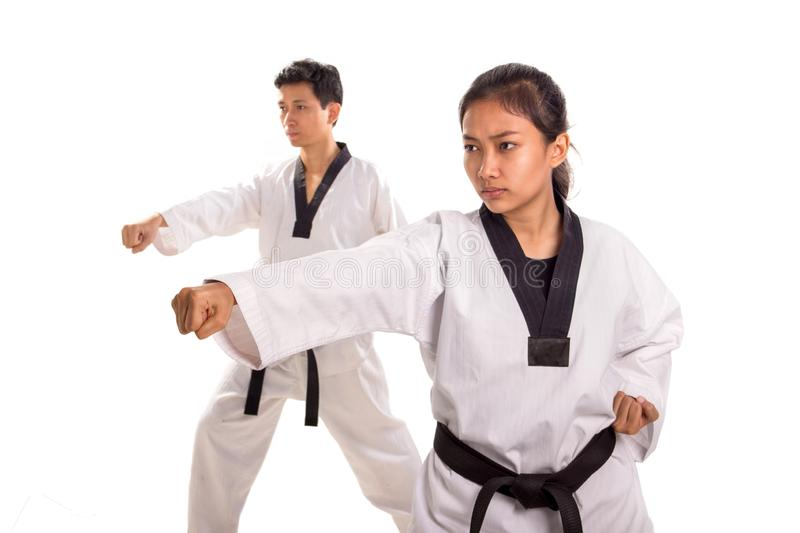 Asian martial artists couple training straight punch, closeup royalty free stock photography