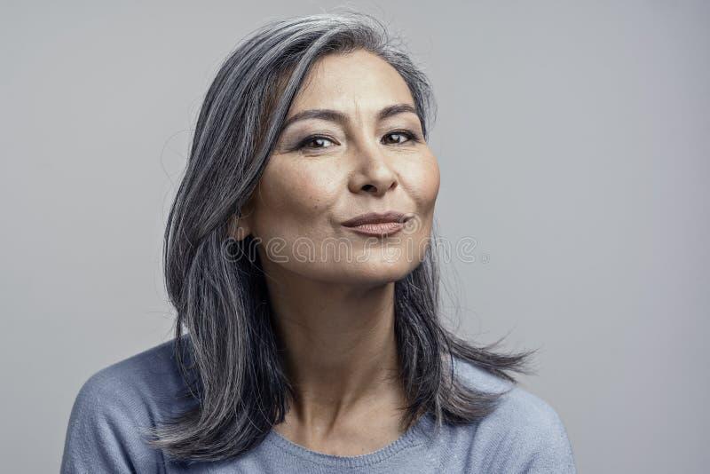 Asian Mature Female Studio Portrait stock images