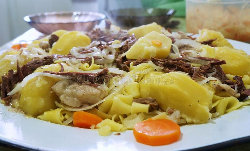 Asian meat dish!. Boiled potatoes, shopped, vegetable, onion, carrot, noodles, national cuisine, Turkic peoples, Asia, traditional meal, fervent food, beshbarmak royalty free stock image