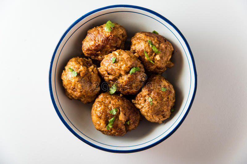 Asian Meatballs on Isolated Background. Asian Meatballs placed in a big bowl stock image